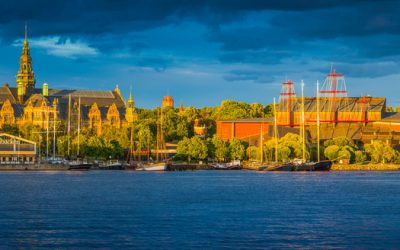 Stockholm, Sweden - July 7, 2016: Golden sunset light illuminating the iconic cultural centres of Djurgarden, from the Nordic Museum, past the Junibacken Children's Museum to the Vasa Museum and the Ladugardslandsviken harbour in the heart of Stockholm, Sweden's vibrant capital city. Composite panoramic image created from ten contemporaneous sequential photographs.